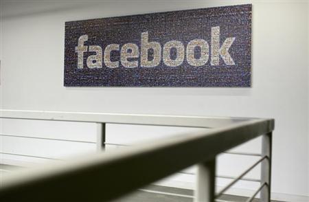 The Facebook logo is pictured in the Facebook headquarters in Menlo Park, California January 29, 2013. REUTERS/Robert Galbraith