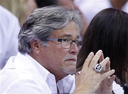 Micky Arison, owner of the Miami Heat and Cruise operator Carnival Corp's chief executive, watches the Heat play the Indiana Pacers during Game 5 of their NBA Eastern Conference final basketball playoff in Miami, Florida in this May 30, 2013 file photo. REUTERS/Joe Skipper/Files