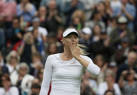 Maria Sharapova of Russia reacts after defeating Kristina Mladenovic of France in their women's singles tennis match at the Wimbledon Tennis Championships, in London June 24, 2013. REUTERS/Stefan Wermuth