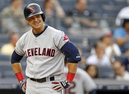 Cleveland Indians' Nick Swisher reacts to striking out against the New York Yankees during the first inning of their MLB American League baseball game at Yankee Stadium in New York June 3, 2013. REUTERS/Adam Hunger