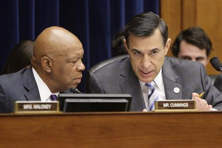 Committee chairman U.S. Representative Darrell Issa (R-CA) (R) and ranking member Rep. Elijah Cummings (D-MD) (L) confer during a House Oversight and Government Reform Committee hearing on targeting of political groups seeking tax-exempt status from by the IRS, on Capitol Hill in Washington, May 22, 2013. REUTERS/Jonathan Ernst