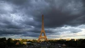 The Eiffel Tower is seen under clouds in Paris May 28, 2013. REUTERS/Benoit Tessier