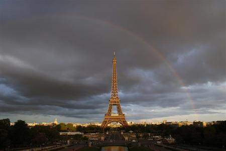 A rainbow appears at the Eiffel Tower in Paris May 28, 2013. REUTERS/Benoit Tessier/Files