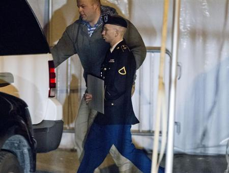 U.S. Army Private First Class Bradley Manning leaves the courthouse after his motion hearing in Fort Meade, Maryland February 28, 2013. REUTERS/Jose Luis Magana