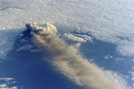 The Pavlof Volcano in Alaska is pictured in this May 18, 2013 NASA handout photo taken by astronauts aboard the International Space Station. Situated in the Aleutian Arc about 625 miles (1,000 km) southwest of Anchorage, Pavlof began erupting on May 13, 2013. NASA/Handout via Reuters