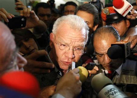 Andres Granier (C), former governor of Tabasco state, speaks to the media upon his arrival at the international airport in Mexico City June 11, 2013. REUTERS/Bernardo Montoya