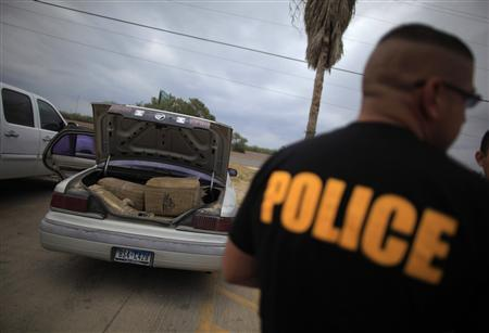 A car filled with bales of marijuana is seen at a police station in La Grulla, Texas, March 28, 2013. REUTERS/Eric Thayer