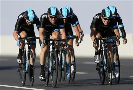 Team Sky riders cycle during the second stage of the 2013 cycling Tour of Qatar, a 14km team time trial along Al Rufaa Street in Doha February 4, 2013. REUTERS/Fadi Al-Assaad