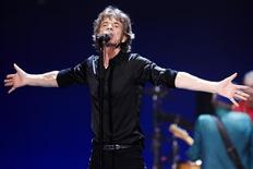 "Mick Jagger of the Rolling Stones performs at a concert during the band's ""50 and Counting"" tour in Chicago May 28, 2013. REUTERS/John Gress"