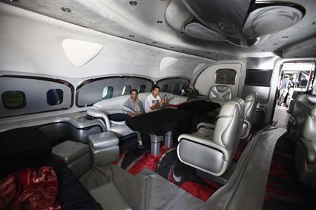 Libyan rebel fighters sit at the sitting room of Muammar Gaddafi's private plane at the international airport in Tripoli in an August 28, 2011 file photo. REUTERS/Zohra Bensemra/files
