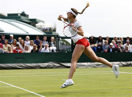 Alize Cornet of France hits a return to Hsieh Su-Wei of Taiwan in their women's singles tennis match at the Wimbledon Tennis Championships, in London June 26, 2013. REUTERS/Eddie Keogh