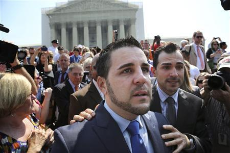 Paul Katami (R) and Jeff Zarrillo, plaintiffs in the case against California's gay marriage ban known as Prop 8, depart the Supreme Court in Washington, June 26, 2013. REUTERS/Jonathan Ernst