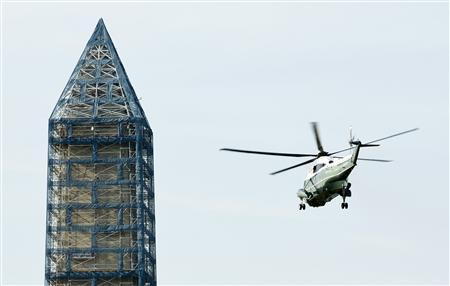 The Marine One carrying U.S. President Barack Obama, First Lady Michelle, their daughters Malia and Sasha, Maran Robinson and Leslie Robinson passes the Washington Monument after departing from the White House in Washington, June 26, 2013. REUTERS/Joshua Roberts/Pool