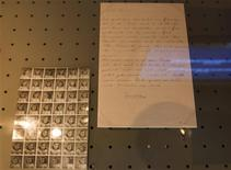 A letter from Anne Frank to her grandmother is seen on display at the Anne Frank Museum in Amsterdam in this June 26, 2013 handout from the Anne Frank Foundation. An archive of documents related to Anne Frank and her family must be returned to a foundation in Switzerland, an Amsterdam court ruled on Wednesday, settling a dispute between two institutions with a claim on her name. The legal battle between Anne Frank House, the Amsterdam museum dedicated to her memory, and Anne Frank Fonds, the Basel-based foundation set up by her father Otto, centred on where the thousands of photographs, letters and other documents should be kept and displayed. REUTERS/Cris Toala Olivares/Anne Frank Foundation/Handout via Reuters