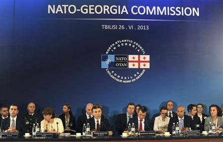 NATO Secretary General Anders Fogh Rasmussen (3rd R, front) and Georgia's Prime Minister Bidzina Ivanishvili (3rd L, front) attend a session of the North Atlantic Council in Tbilisi, June 26, 2013. REUTERS/Ivan Shlamov/Pool