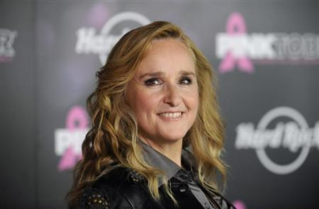 Singer Melissa Etheridge poses for photographers after receiving a star on the Hollywood Walk of Fame in Los Angeles September 27, 2011. REUTERS/Phil McCarten
