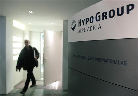 A man leaves the office of nationalised Austrian lender Hypo Alpe Adria in Vienna March 12, 2013. REUTERS/Heinz-Peter Bader