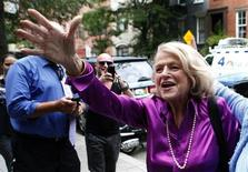 "Edith ""Edie"" Windsor (C) reacts to cheers as she arrives for a news conference following the U.S. Supreme Court 5-4 ruling striking down as unconstitutional the Defense of Marriage Act, in New York June 26, 2013. REUTERS/Mike Segar"