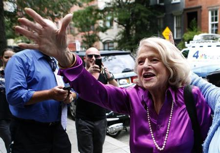 Edith ''Edie'' Windsor (C) reacts to cheers as she arrives for a news conference following the U.S. Supreme Court 5-4 ruling striking down as unconstitutional the Defense of Marriage Act, in New York June 26, 2013. REUTERS/Mike Segar