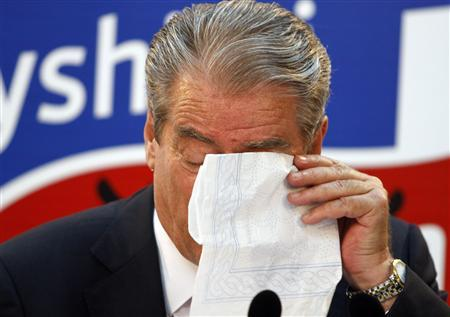 Albania's Prime Minister Sali Berisha wipes his tears during a news conference in Tirana June 26, 2013. REUTERS/Arben Celi