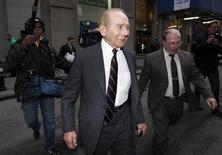 "Former CEO of American International Group Inc., Maurice ""Hank"" Greenberg, (C) leaves a building in downtown New York after being deposed by the Attorney General's office March 10, 2010. REUTERS/Jessica Rinaldi"