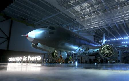Bombardier unveils its CSeries aircraft at a news conference at its assembly facility in Mirabel, Quebec, March 7, 2013. REUTERS/Christinne Muschi