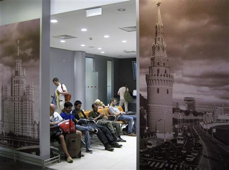People spend time in a waiting room at the transit area of Moscow's Sheremetyevo airport June 26, 2013. REUTERS/Sergei Karpukhin