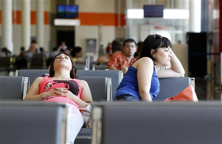 People sit in a waiting room at Moscow's Sheremetyevo airport June 26, 2013. REUTERS/Sergei Karpukhin