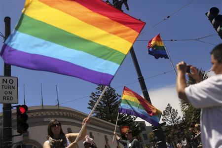 Same-sex marriage supporters take pictures in the Castro neighborhood in San Francisco, California after the U.S. Supreme Court ruled on California's Proposition 8 and the federal Defense of Marriage Act June 26, 2013. REUTERS/Robert Galbraith