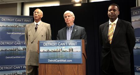 Lawyer Kevyn Orr (R) and Detroit Mayor Dave Bing (L) listen as Michigan Governor Rick Snyder announces Orr as his choice for emergency financial manager for the city of Detroit, in the state offices at Cadillac Place in Detroit, Michigan March 14, 2013. REUTERS/ Rebecca Cook
