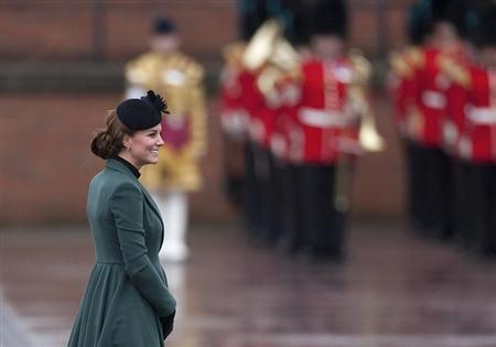 Britain's Catherine, Duchess of Cambridge smiles during a visit with her husband, Prince William, to attend a St Patrick's Day Parade at Mons Barracks in Aldershot, southern England March 17, 2013. REUTERS/Kieran Doherty