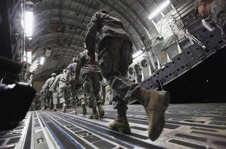 Soldiers from the 3rd Brigade, 1st Cavalry Division board a C-17 transport plane to depart from Iraq at Camp Adder, now known as Imam Ali Base, near Nasiriyah, December 17, 2011. Picture taken December 17, 2011. REUTERS/Mario Tama/Pool