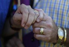 Married couple Bill Hacket, 53, (L) and Thom Uber hold hands in West Hollywood, California after the United States Supreme court ruled on California's Proposition 8 and the federal Defense of Marriage Act, June 26, 2013. REUTERS/Lucy Nicholson