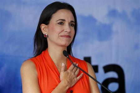 Legislator Maria Corina Machado attends a news conference in Caracas January 25, 2012. REUTERS/Jorge Silva