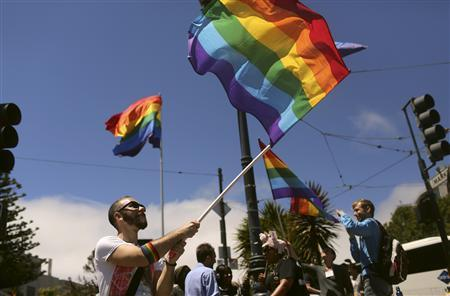 Supporters of same-sex marriage wave flags in the Castro neighborhood in San Francisco, California after the United States Supreme Court ruled on California's Proposition 8 and the federal Defense of Marriage Act June 26, 2013. REUTERS/Robert Galbraith