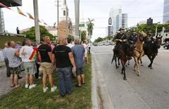 Mounted Fort Lauderdale police officers ride past a rally by gay rights activists following the U.S. Supreme Court's 5-4 ruling, striking down as unconstitutional the Defense of Marriage Act (DOMA), in Fort Lauderdale, Florida June 26, 2013. REUTERS/Joe Skipper