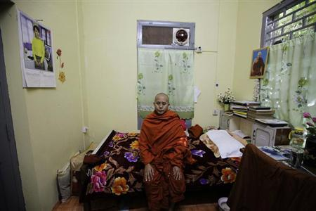 Wirathu, a Buddhist monk, poses for a photo in his room after an interview with Reuters at a monastery in Mandalay December 16, 2012. REUTERS/Soe Zeya Tun/Files
