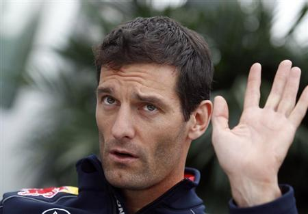 Red Bull Formula One driver Mark Webber of Australia waves from his paddock ahead of the Canadian F1 Grand Prix at the Circuit Gilles Villeneuve in Montreal, June 6, 2013. REUTERS/Christinne Muschi