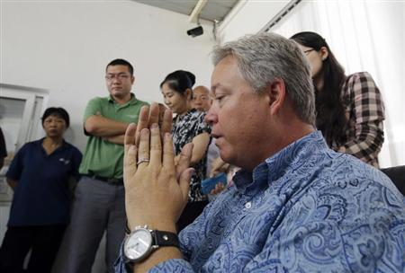 Chip Starnes (R), president of Florida-based Speciality Medical Supplies, talks as his workers (L and 2nd L) listen during his news conference at the company's factory in the outskirts of Beijing June 26, 2013. REUTERS/Kim Kyung-Hoon