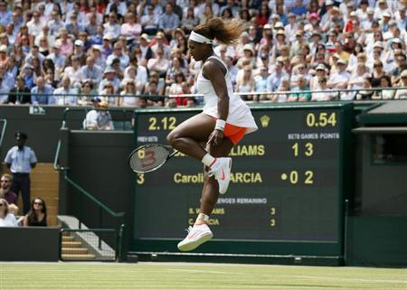 Serena Williams of the U.S. jumps as she reacts during her women's singles tennis match against Caroline Garcia of France at the Wimbledon Tennis Championships, in London June 27, 2013. REUTERS/Stefan Wermuth