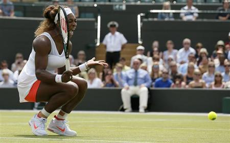 Serena Williams of the U.S. reacts to hitting a shot into the net during her women's singles tennis match against Caroline Garcia of France at the Wimbledon Tennis Championships, in London June 27, 2013. REUTERS/Stefan Wermuth
