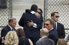 Mourners embrace outside the funeral services of James Gandolfini at the Cathedral Church of Saint John the Divine for funeral services in New York June 27, 2013. REUTERS/Lucas Jackson