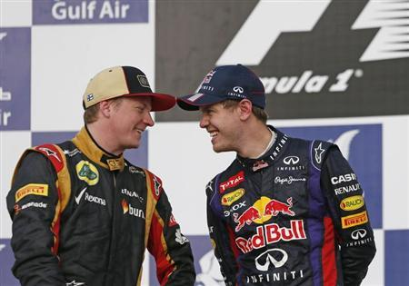 Lotus Formula One driver Kimi Raikkonen of Finland shares a laugh with Red Bull Formula One driver Sebastian Vettel (R) of Germany after the Bahrain F1 Grand Prix at the Sakhir circuit, south of Manama April 21, 2013. REUTERS/Darren Whiteside