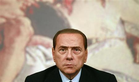 Italy's former Prime Minister Silvio Berlusconi looks on during a news conference at Chigi Palace in Rome August 4, 2011. REUTERS/Tony Gentile