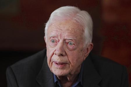 Former U.S. President Jimmy Carter speaks during an interview with Reuters in Kathmandu April 1, 2013. REUTERS/Navesh Chitrakar