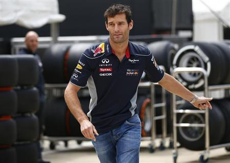 Red Bull Formula One driver Mark Webber of Australia arrives ahead of the British Grand Prix at the Silverstone Race circuit, central England, June 27, 2013. REUTERS/Darren Staples