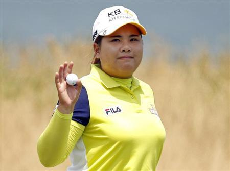 Inbee Park of South Korea acknowledges the crowd on the 9th green at the end of her first round of the 2013 U.S. Women's Open golf championship at the Sebonack Golf Club in Southampton, New York June 27, 2013. REUTERS/Adam Hunger