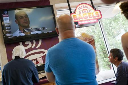 People watch a television at Dunkin Donuts as New England Patriots tight end Aaron Hernandez is arraigned next door in the Attleborough District Court, after being arrested, June 26, 2013. REUTERS/Dominick Reuter