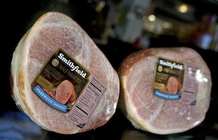 Smithfield hams line the shelves at the Taste of Smithfield restaurant and gourmet market in Smithfield, Virginia May 30, 2013. REUTERS/Rich-Joseph Facun