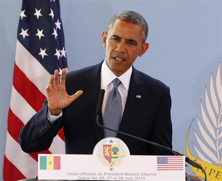 U.S. President Barack Obama speaks at a joint news conference with Senegal's President Macky Sall (not pictured) at the Presidential Palace in Dakar, June 27, 2013. REUTERS/Jason Reed